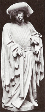 Medieval statue of a man wearing a long houppelande