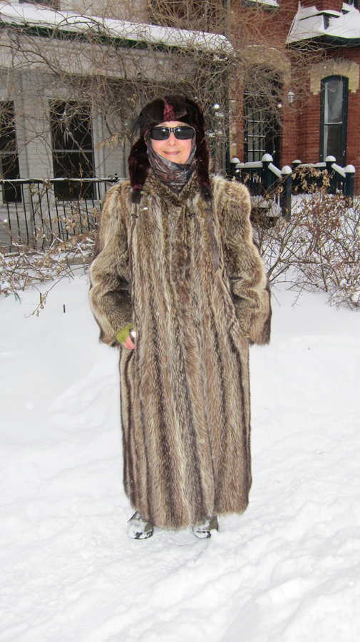 Helena in her racoon coat on a snowy day.