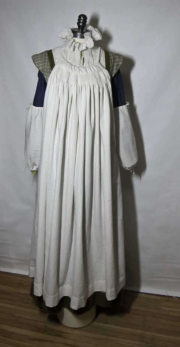 Apron and scoggers worn over gown