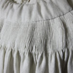 Detail of reverse-smocked yoke