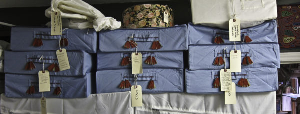 Image of part of the stash stored in blue zip-up IKEA containers with red tassels